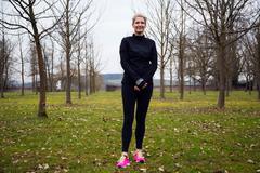 female runner in park - stock photo