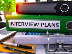 Green Office Folder with Inscription Interview Plans Piirros
