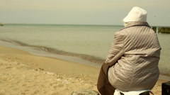 Granny sit near sea - stock footage