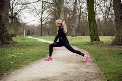 Attarcive woman stretching in park Stock Photos