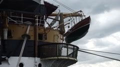 A lifeboat rear of historical ship - stock footage