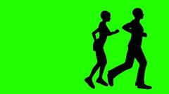 Runners jog across green screen Arkistovideo