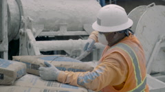 Construction worker Opening Bag of Cement - Super Slow Motion 240FPS - stock footage
