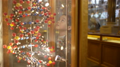 4K Mother & little boy in science museum looking at DNA molecules in cabinet - stock footage