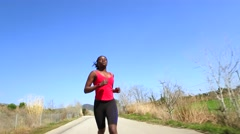 African teen girl running outdoors Stock Footage