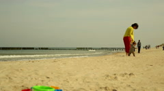 Mother with baby walking at the beach Stock Footage