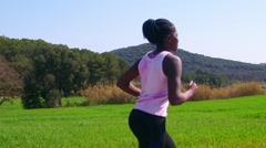 Young african teen jogger in slow motion. Stock Footage