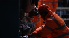 4KEngineering team carrying out maintenance in power plant with foreman watching - stock footage