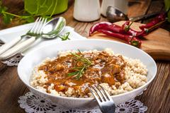 Cooked barley porridge and stew of pork. Stock Photos