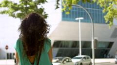 Woman walk on city of oPorto: Casa da Música view. Stock Footage
