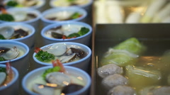 Chinese, Taiwanese open style, meatballs and seafood steamed egg with hot soup Stock Footage