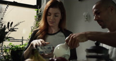 Couple having breakfast together at home - stock footage