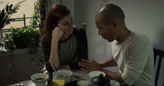 Couple talking while having breakfast at home - stock footage