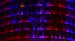 Cool light show reflected on all-glass skyscraper, modern art and decoration Stock Footage