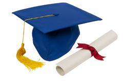 Graduation Cap With Diploma - stock photo