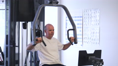 Retired Bald Man Using Weights To Workout - stock footage