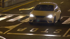 Night driving in Europe, cars observing traffic rules, road surface marking Stock Footage