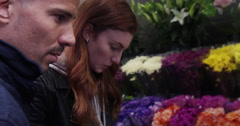 Young couple choosing flower bouquet at florist's shop Stock Footage