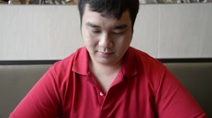 Portrait of Fat Chinese-Thai  Asian male in red shirt with smile face Stock Footage