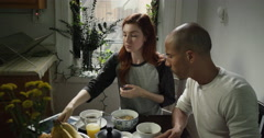 Young couple having breakfast together at home - stock footage