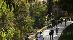 Tourists visiting driveway of an old fortress Stock Footage
