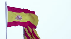 Spanish and Catalan flags waving in wind, freedom sign, nationality, patriotism Stock Footage