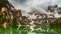 Storm clouds over mountains of the lake Pragser Wildsee in the Dolomites Stock Footage