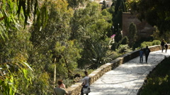 Tourists visiting driveway of an old fortress called in Malaga, Spain Stock Footage