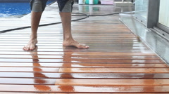 Outdoor wood floor cleaning with high pressure water jet Stock Footage