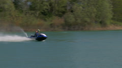 Water scooter or Personal water craft (PWC) raising big splashes. Stock Footage