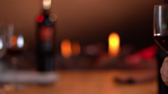 Intimate, warm atmosphere with slow motion toast with red wine - stock footage