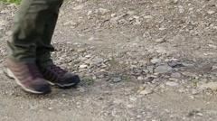 Woman walking in trekking shoes Stock Footage