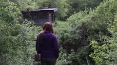 Girl admiring the view of a mountain forest Stock Footage