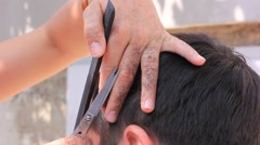 Barber makes a man's hairstyle Stock Footage