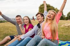 Great sunny day with best friends in park. Positive emotions. - stock photo