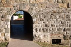 Arched Doorway in a Medieval Stone Wall Stock Photos