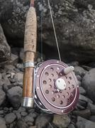 Close-up of fishing rod and reel - stock photo