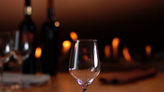 Intimate, warm atmosphere with slow motion pouring of red wine - stock footage