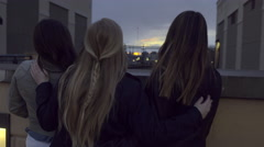 Group Of Teens Watch The Sunset, Girl In Middle Puts Her Arms Around Friends Stock Footage
