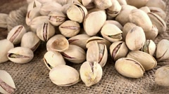 Rotating Pistachios (seamless loopable; 4K) Stock Footage