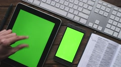 Tablet and Smartphone on table Stock Footage