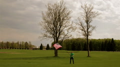 Man waving American flag on a glade - stock footage