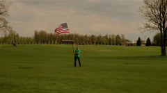 Man waving American flag on a glade Stock Footage
