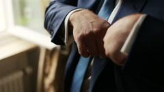 Handsome groom puts handkerchiefs in the suit. Wedding preparation Stock Footage