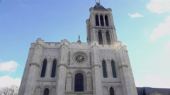 Majestic Basilica of Saint Denis church against sunny bright blue sky background Stock Footage