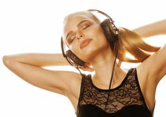 Young sweet talented teenage girl in headphones singing isolated on white Stock Photos