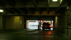 Suv Driving out of Parking Garage Stock Footage