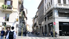 Pedestrian in Monte Napoleone, Milan walk looking showcase shopping - spring day Stock Footage
