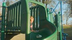 Little Girl Sliding down a Twisty Slide Stock Footage