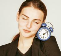 Young beauty woman in business style costume waking up for work early morning on Stock Photos